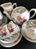 A mixed continental tea service for six